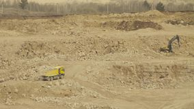 Truck driving in quarry. Truck driving in a quarry. Work in a quarry. Trucks and excavators stock video
