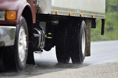 Truck driving in rain. White pick up truck driving fast in rain on wet road Royalty Free Stock Image