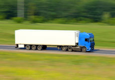 Truck driving on a road Stock Photography