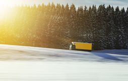 Truck driving on road in Switzerland in winter and snow Royalty Free Stock Image