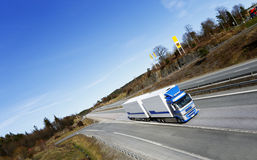 Truck driving on scenic highway Stock Photography