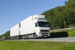 Truck driving on scenic road Royalty Free Stock Photos