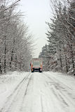 Truck driving in the snow in the countryside Royalty Free Stock Photography