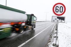 Truck driving on snowy road Royalty Free Stock Images