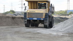 Truck driving through stone quarry stock footage