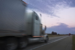 Truck driving during sunset Royalty Free Stock Photography