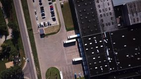Truck is Driving to Logistics Center. Aerial Shot. Unloading cargo. Logistics stock video footage