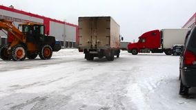 Truck driving on the warehouse. Truck driving on the territory of the warehouse by snowy road stock footage