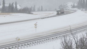 Truck driving in winter snow conditions. Truck driving on the highway during icy winter road conditions stock video