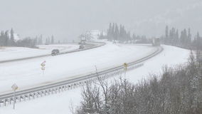 Truck driving in winter snow conditions. Truck driving on the highway during icy winter road conditions stock footage