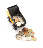 Truck dump toy and coins Stock Images