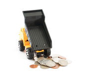 Truck dump toy and coins on white background Royalty Free Stock Photography