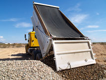 Truck Dumping Gravel Stock Photos