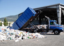 Truck dumping recyclable paper and plastic Royalty Free Stock Images