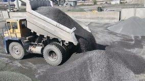 Truck dumping stones into quarry stock video