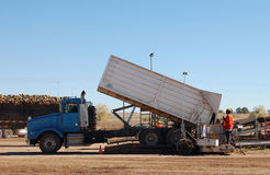 Truck dumping sugarbeets at a Western Sugar pile ground during fall harvest Royalty Free Stock Photos