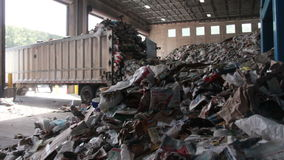 A Truck Dumps Trash to be Recycled (8 of 10) stock video