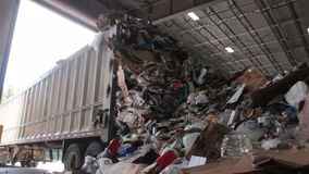A Truck Dumps Trash to be Recycled (10 of 10). Trash being delivered at the recycling center stock video