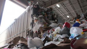 A Truck Dumps Trash to be Recycled (2 of 10). Trash being delivered at the recycling center stock video footage