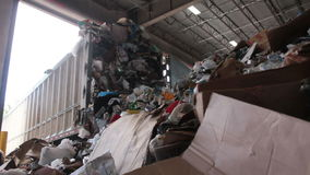 A Truck Dumps Trash to be Recycled (1 of 10). Trash being delivered at the recycling center stock video footage