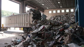 A Truck Dumps Trash to be Recycled (6 of 10). Trash being delivered at the recycling center stock footage