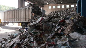 A Truck Dumps Trash to be Recycled (7 of 10). Trash being delivered at the recycling center stock video