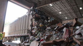 A Truck Dumps Trash to be Recycled (9 of 10). Trash being delivered at the recycling center stock video