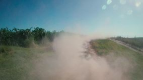 Truck with dust in its back. Truck leaving dust in its back among vineyard stock footage
