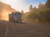 Truck in dust road. Truck in strong dust road - Route 65 - Enchanted Valley - Bariloche - Neuquen - Rio Negro - Patagonia - Argentina Royalty Free Stock Photography