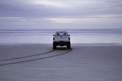 Truck on empty beach Stock Photo