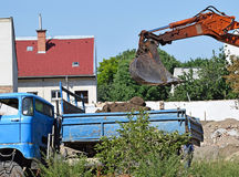 Truck and excavator at the road construction Royalty Free Stock Photo