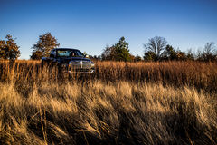 Truck in a field stock images