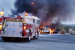 Truck Fire 4. Firemen fight a fire that has involved  industrial trucks Royalty Free Stock Photos