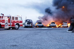 Truck Fire 5. Firemen fight a fire that has involved several industrial trucks Stock Photo