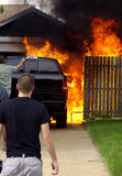Truck Fire. Out of control backyard fire consumes truck Stock Photography