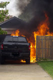 Truck Fire. Out of control backyard fire consumes new truck Royalty Free Stock Photos