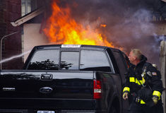 Truck Fire. Out of control backyard fire consumes truck Royalty Free Stock Photos