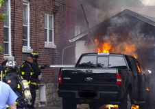 Truck Fire. Out of control backyard fire consumes truck Royalty Free Stock Photo