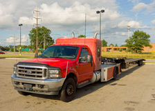 A truck and flat-bed trailer used for cargo Royalty Free Stock Images
