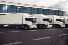 Truck fleet. Line of trucks parked on the road Stock Images