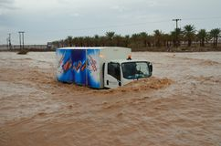 Truck in flooded wadi Stock Images