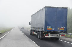 Truck and fog. Truck on aroad wiyh fog Royalty Free Stock Photography