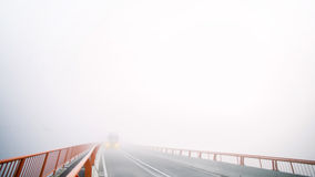 Truck on foggy bridge Royalty Free Stock Images