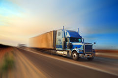 Truck freight delivery. Delivery freight shipping truck on freeway at sunset stock image