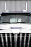 Truck. Front close-up view of a clean white and blue truck in front of a garage Royalty Free Stock Image