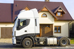 Truck in front of  suburban house. Truck in front of new suburban house Royalty Free Stock Photography