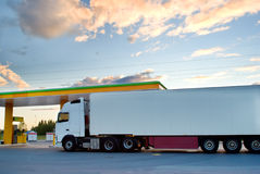 Truck is at a fuel station. White truck is at a fuel station royalty free stock image