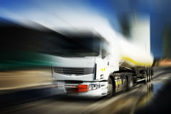 Truck with fuel tank. Speeding truck with white fuel tank and blurred background Royalty Free Stock Photos