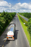 Truck with fuel tank on highway. And sky with clouds Royalty Free Stock Photo