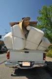 Truck full of furniture. Truck if overflowing with furniture Stock Photo
